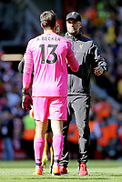 Liverpool's Alisson Becker and manager Jurgen Klopp  console each other as they are left dejected at the final whistle<br /> <br /> Photographer Rich Linley/CameraSport<br /> <br /> The Premier League - Liverpool v Wolverhampton Wanderers - Sunday 12th May 2019 - Anfield - Liverpool<br /> <br /> World Copyright © 2019 CameraSport. All rights reserved. 43 Linden Ave. Countesthorpe. Leicester. England. LE8 5PG - Tel: +44 (0) 116 277 4147 - admin@camerasport.com - www.camerasport.com