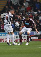 Steven Thompson takes on Darren Barr in the St Mirren v Heart of Midlothian Clydesdale Bank Scottish Premier League match played at St Mirren Park, Paisley on 15.9.12.