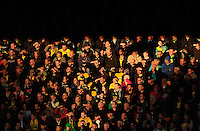 Norwich City fans shield their eyes from the sun during the Barclays Premier League match between Norwich City and Swansea City played at Carrow Road, Norwich on November 7th 2015