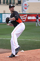 Miami Marlins pitcher Mitch Talbot (21) warms up in the bullpen against the Houston Astros during a spring training game at the Roger Dean Complex in Jupiter, Florida on March 12, 2013. Houston defeated Miami 9-4. (Stacy Jo Grant/Four Seam Images)........