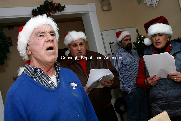TORRINGTON, CT, 12/12/08- 121208BZ04- Fred Eible, a resident at The Manor on Pine Street, left, sings Christmas carols with the Hillside Historic District Neighborhood Association carolers Saturday night.  The group, consisting of eight people, sang at The Manor before heading off to carol for residents of Mattatuck Healthcare and The Carriage Manor, LLC.  Also in the photo are Joe Puzzo, resident John Palmieri, and Debbie Cronin.<br /> Jamison C. Bazinet Republican-American