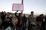 Demonstrators protest across the street from what remains of the Shepherd Hotel in the Sheikh Jarrah neighborhood in East Jerusalem during a protest against Jewish settlement of Arab East Jerusalem following the buildings demolition on 09 January 2011. The Jerusalem Building Council last year cleared the way for the hotel, built in the 1930s, to be turned into a new Jewish settlement in the middle of Arab East Jerusalem, despite condemnation from U.S. President Barack Obama's administration. Photo by Mahfouz Abu Turk