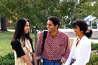 Ethnic college students from India relaxing outside classes on campu