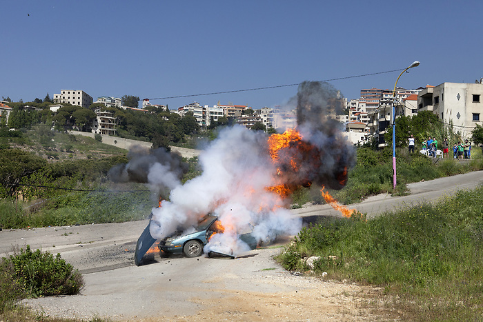 "Shooting of the series ""Qawalis al Madina"" (""behind the city's wall"") Lebanon, April 2016 (Assada Production). The scene replicates a car bombing: the story mixes three criminal cases involving politics and corruption that shook Lebanon a few years earlier. It was produced on the initiative of journalist Ghada Eid, who wanted to raise public awarness by using elements of real life.<br /> <br /> Tournage de la série ""Qawalis al Madina"" (""Les coulisses de la cité""), Liban, Avril 2016 (Assada Production) . La scène reproduit un attentat: l'intrigue mêle trois affaires criminelles qui ont ébranlé le Liban quelques années plus tôt, impliquant politiques et faits de corruption. La série libanaise, produite à l'initiative de la journaliste Ghada Eid, innove en s'inspirant de faits réels."