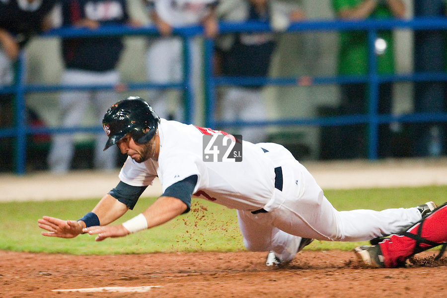 24 September 2009: Josh Kroeger of Team USA dives into homeplate to score during the 2009 Baseball World Cup final round match won 5-3 by Team USA over Cuba, in Nettuno, Italy.