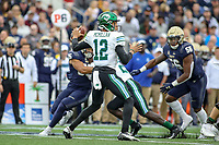 Annapolis, MD - October 26, 2019: Tulane Green Wave quarterback Justin McMillan (12) throws a pass during the game between Tulane and Navy at  Navy-Marine Corps Memorial Stadium in Annapolis, MD.   (Photo by Elliott Brown/Media Images International)