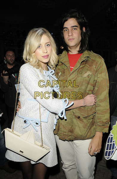 Peaches Geldof & Thomas Cohen.attended the Moschino cheap and chic LFW a/w 2013 catwalk show, LFW day 2, Savoy Hotel, The Strand, London, England..February 16th, 2013.half length grey gray tweed jacket skirt bag purse white sailboat origami bag purse camouflage jacket arms around waist hug embrace married husband wife pregnant .CAP/CAN .©Can Nguyen/Capital Pictures.