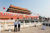 Two female police officer watch crowds atTiananmen Gate, Beijing, China, Asia