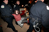 Nov. 30, 2011 - Charlottesville, Virginia - USA; An occupier is removed from Lee Park by several officers after she resisted arrest. Charlottesville occupiers were arrested late Wednesday night after their special-event permit expired and police resumed enforcement of the 11 p.m. curfew in Lee park. (Credit Image: The Daily Progress/ Andrew Shurtleff)