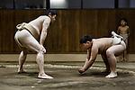Tokyo, March 31 2013 - Former professionnal sumo wrestler Shinichi Taira coaching the young Kato Seiya at an amateur sumo club in the Asakusa area.