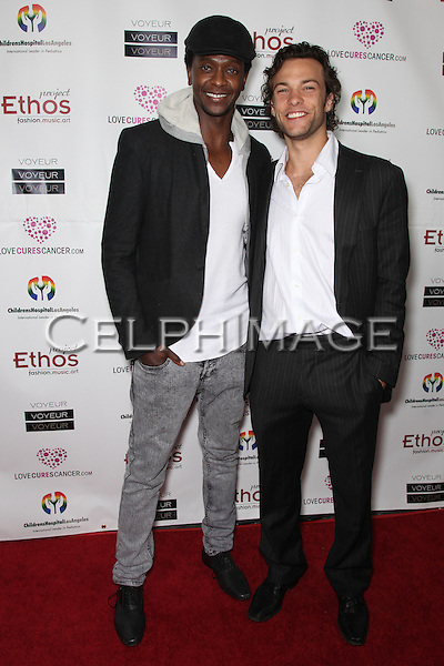 EDI GATHEGI, KYLE SCHMID. Arrivals to Take a Chance On Love 2 Charity Benefit, presented by Love Cures Cancer at Voyeur nightclub, West Hollywood, CA, USA.February 10th, 2010.
