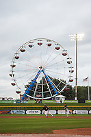 Quad Cities River Bandits outfielder Jason Martin (16) leads off second base in front of a giant Ferris wheel during the first game of a doubleheader against the Wisconsin Timber Rattlers on August 19, 2015 at Modern Woodmen Park in Davenport, Iowa.  Quad Cities defeated Wisconsin 3-2.  (Mike Janes/Four Seam Images)