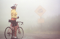 A cyclist at the summit of Coal Bank Pass on Highway 550 north of Durango, Colorado in  fall, 2002.
