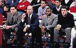 University of Wisconsin coaching staff during the South Florida game at the Kohl Center in Madison, WI, on 12/30/00. Wisconsin beat South Florida in overtime, 63-61. From left, Paul Costanzo, Brad Soderberg, Shawn Hood and Tony Bennett. (Photo by David Stluka)