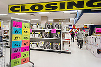 Customers search for bargains at the soon to be closing Sears store in the New York borough of the Bronx on Sunday, October 26, 2014. Sears Holdings announced that it will close 77 Sears and Kmart stores prior to the Christmas holiday. This is in addition to previously announced closings and over 7000 jobs will be lost. (© Richard B. Levine)