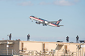 President-elect Trump's private plane rises into the air at Laguardia Airport as as heavily armed Secret Service agents watch from the roof of a building near the airstrip, in New York, NY, USA on December 1, 2016. <br /> Credit: Albin Lohr-Jones / Pool via CNP