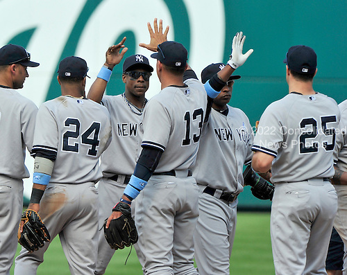 New York Yankees celebrate their 4 - 1 victory over the Washington Nationals at Nationals Park in Washington, D.C. on Sunday, June 17, 2012.  .Credit: Ron Sachs / CNP.(RESTRICTION: NO New York or New Jersey Newspapers or newspapers within a 75 mile radius of New York City)