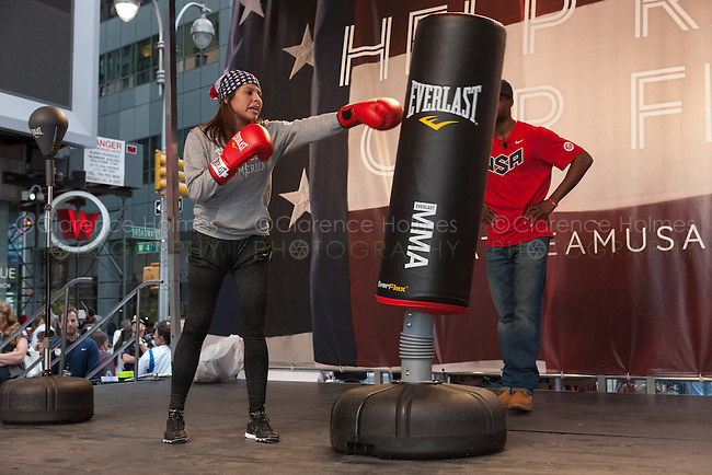 USA Olympic Boxing Team member Marlen Esparza participates in a boxing demonstration at the Road to London 100 Days Out Celebration in Times Square in New York City, New York, USA on Wednesday, April 18, 2012.  Times Square was transformed into an Olympic Village for the event.