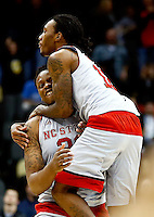 PITTSBURGH, PA - MARCH 19:  Beejay Anya #21 of the North Carolina State Wolfpack celebrates with teammate Anthony Barber #12 after defeating the LSU Tigers 66 to 65 during the second round of the 2015 NCAA Men's Basketball Tournament at Consol Energy Center on March 19, 2015 in Pittsburgh, Pennsylvania.  (Photo by Jared Wickerham/Getty Images)
