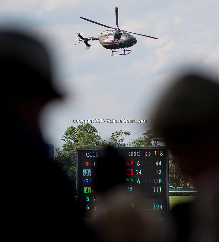 ELMONT, NY - JUNE 10: Fans watch the Black Knights parachute in on Belmont Stakes Day at Belmont Park on June 10, 2017 in Elmont, New York (Photo by Scott Serio/Eclipse Sportswire/Getty Images)