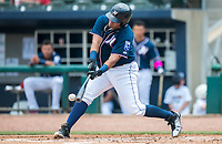 NWA Democrat-Gazette/CHARLIE KAIJO Northwest Arkansas Naturals first baseman Samir Duenez (13) contacts the ball during a baseball game, Sunday, May 13, 2018 at Arvest Ballpark in Springdale.