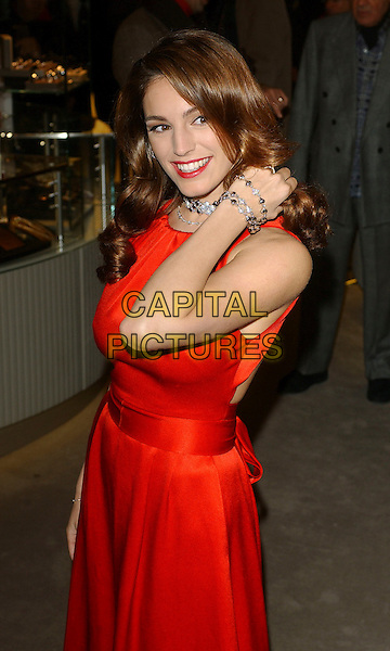 KELLY BROOK  .Opening of Harrods January Sale, KNightsbridge, London, UK..December 28th, 2006.Ref: BEL.half length red dress bracelets.www.capitalpictures.com.sales@capitalpictures.com.© Capital Pictures.