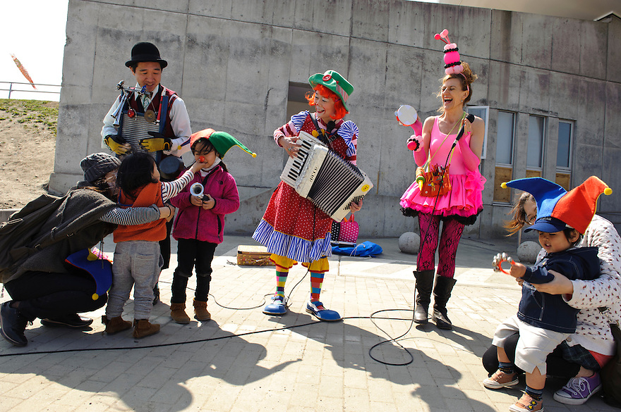 Performing for children outside the Mangattan Manga Museum, Ishinomaki, Miyagi Prefecture, Japan, May 5, 2011. Rakugo-ka (comic story-teller) and balloon artist Diane Kichijitsu travelled with other performers to Ishinomaki to perform of victims of the March 11 earthquake and tsunami.