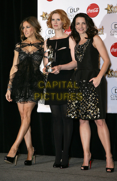 SARAH JESSICA PARKER, CYNTHIA NIXON & KRISTIN DAVIS .SHOWEST Final Night Talent Awards at the Paris Resort Hotel and Casino,  Las Vegas, Nevada , USA,.18th March 2010..full length black dress dresses SATC Sex and the city sleeveless cut out shoes christian Louboutin heels peep toe silk tulle layered gold metal studs embellished award trophy winner winners SJP.CAP/ADM/MJT.© MJT/AdMedia/Capital Pictures.