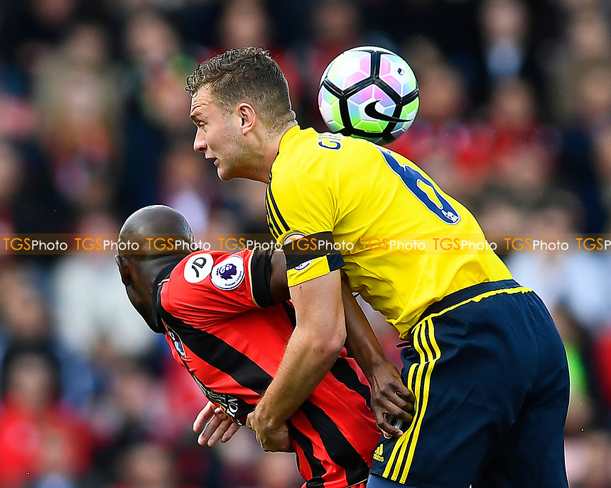 Ben Gibson of Middlesbrough takes hold of Benik Afobe of AFC Bournemouth during AFC Bournemouth vs Middlesbrough, Premier League Football at the Vitality Stadium on 22nd April 2017