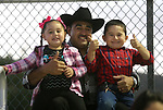 The Munoz family watches the 5th Annual Carson City Bulls, Broncs &amp; Barrels event at Fuji Park, in Carson City, Nev., on Saturday, July 29, 2017. <br />