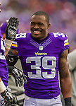 19 October 2014: Minnesota Vikings cornerback Jabari Price smiles on the sidelines in the first quarter against the Buffalo Bills at Ralph Wilson Stadium in Orchard Park, NY. The Bills defeated the Vikings 17-16 in a dramatic, last minute, comeback touchdown drive. Mandatory Credit: Ed Wolfstein Photo *** RAW (NEF) Image File Available ***