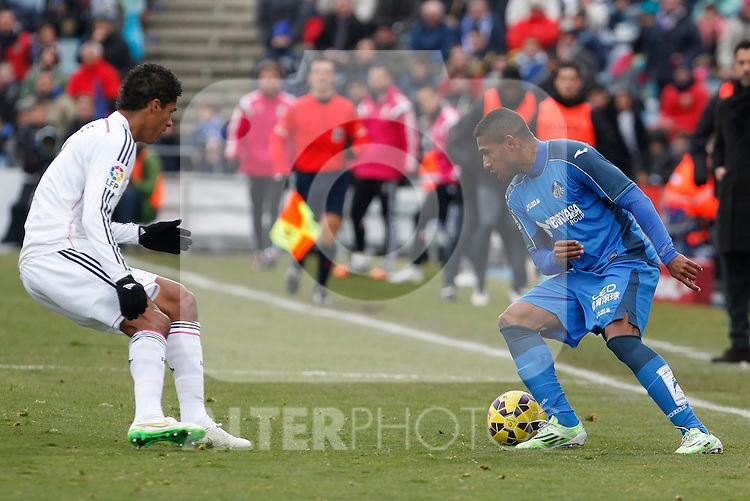 Getafe´s Samir (R) and Real Madrid´s Raphael Varane during La Liga match at Coliseum Alfonso Perez stadium  in Getafe, Spain. January 18, 2015. (ALTERPHOTOS/Victor Blanco)