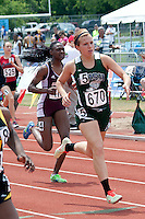 Luthern South sophoore Maya Cody sprints to victory while Springfield Catholic senior Erin Roebuck (670) runs to second place in the Class 3 400 meter dash. Cody finished in 57.27 while Roebuck finished in 58.16.