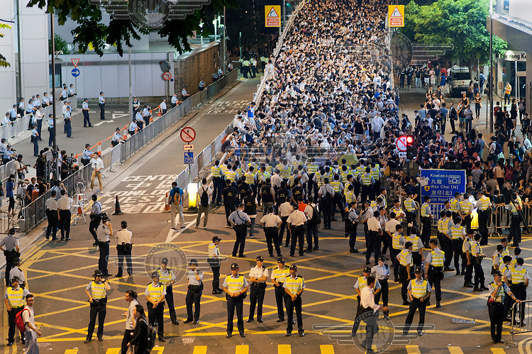 Protesters converge on the police headquarters in the Admiralty area of Hong Kong. The 'Occupy Central ' movement has been organising events of civil disobedience to protest against the Chinese government's electoral policy for Hong Kong. Hong Kong was supposed to be having direct elections for the post of chief executive by 2017 but the government in Beijing has said that the election will only be from a list of pre-approved candidates.