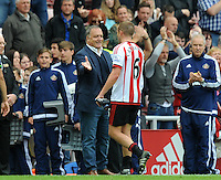 Dick Advocaat manager of Sunderland congratulates Lee Cattermole of Sunderland after the final whistle during the Barclays Premier League match between Sunderland and Swansea City played at Stadium of Light, Sunderland