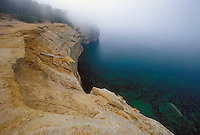The cliffs of Pictured Rocks National Lakeshore in the fog near Munising, Mich.