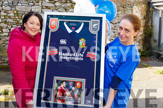 """Corinne Evans presents a signed jersey from Conor Murray's All Black tour to Therese Ahern and it will be raffled off with the proceeds going to """"The Make a Wish Foundation""""."""