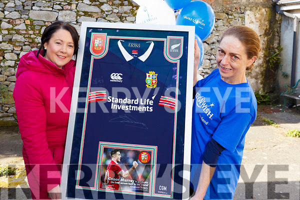 "Corinne Evans presents a signed jersey from Conor Murray's All Black tour to Therese Ahern and it will be raffled off with the proceeds going to ""The Make a Wish Foundation""."