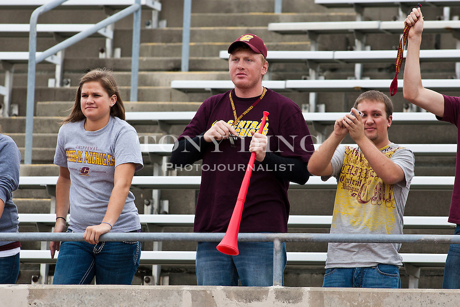A Central Michigan fan holds his vuvuzela in the stands in the first quarter of an NCAA college football game at Eastern Michigan, Saturday, Sept. 18, 2010, in Ypsilanti, Mich. (AP Photo/Tony Ding)
