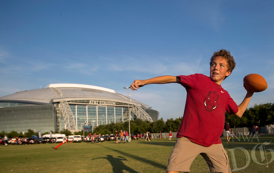NWA Democrat-Gazette/JASON IVESTER<br /> Lawson May, 14, tosses a football with his frined Jackson Rice, 14, both of Little Rock on Saturday, Sept. 24, 2016, before the Razorbacks' game against Texas A&amp;M at AT&amp;T Stadium in Arlington, Texas.