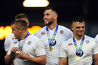 England U20 players are all smiles on the winners podium after the match. World Rugby U20 Championship Final between England U20 and Ireland U20 on June 25, 2016 at the AJ Bell Stadium in Manchester, England. Photo by: Patrick Khachfe / Onside Images