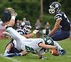 Dilon Smith #20 of Lindenhurst crash lands for a yardage gain during a Suffolk County Division I varsity football game against Northport at Glenn High School on Saturday, Sept. 2, 2017.