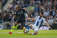 Manchester City's Raheem Sterling (left) battles with Brighton & Hove Albion's Beram Kayal (right) <br /> <br /> Photographer David Horton/CameraSport<br /> <br /> The Premier League - Brighton and Hove Albion v Manchester City - Sunday 12th May 2019 - The Amex Stadium - Brighton<br /> <br /> World Copyright © 2019 CameraSport. All rights reserved. 43 Linden Ave. Countesthorpe. Leicester. England. LE8 5PG - Tel: +44 (0) 116 277 4147 - admin@camerasport.com - www.camerasport.com