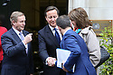 Britain's Prime Minister David Cameron greets the Irish Prime Minister Enda Kenny and his staff as they arrive at Stormont House for day one of a cross-party talks at Stormont House in Belfast, Northern Ireland, Thursday Dec 11, 2014. Cameron and the Irish Prime Minister Enda Kenny are hoping to secure agreement in the talks concerning disputes on flags, parades, the past and welfare reform. Photo/Paul McErlane