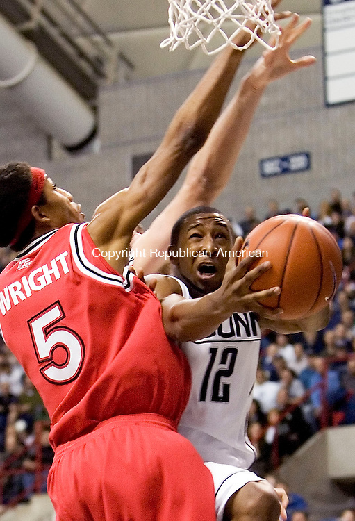 STORRS, CT- 08 JANUARY 2008- 010808JT01-<br /> UConn's A. J. Price jumps between St. John's Larry Wright and Tomas Jasiulionis (partially obscured) and attempts in vain to scored during Tuesday's game in Storrs. <br /> Josalee Thrift / Republican-American
