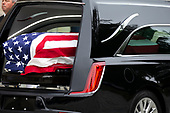 The casket of late Senator John McCain, Republican of Arizona, is seen in the hearse prior to a funeral for the late Senator at the National Cathedral in Washington, DC on September 1, 2018. Credit: Alex Edelman / CNP