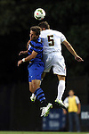 26 September 2014: Duke's Jack Coleman (left) and Boston College's Giuliano Frano (CAN) (5). The Duke University Blue Devils hosted the Boston College Eagles at Koskinen Stadium in Durham, North Carolina in a 2014 NCAA Division I Men's Soccer match. Duke won the game 1-0.