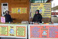 Altai Region, Siberia, Russia, 25/02/2011..Women traders at outdoor roadside cafe in minus 30C.