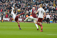 James Collins of West Ham and Aaron Lennon of Burnley  during West Ham United vs Burnley, Premier League Football at The London Stadium on 10th March 2018