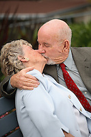 Elderly Couple in Love and Kissing at the Park